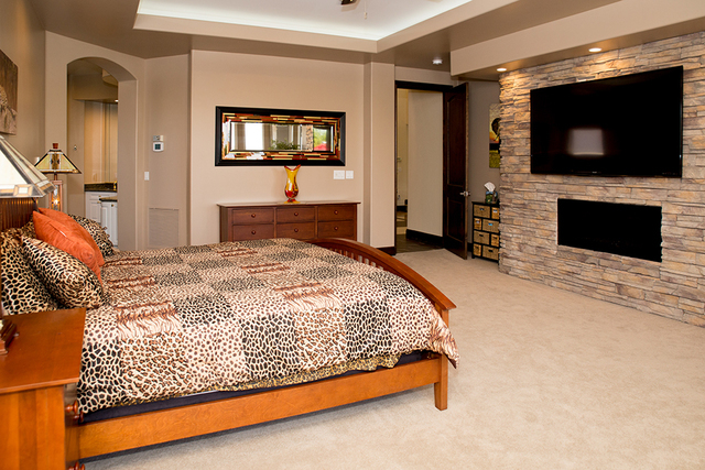 The master suite has a fireplace. (TONYA HARVEY/REAL ESTATE MILLIONS)