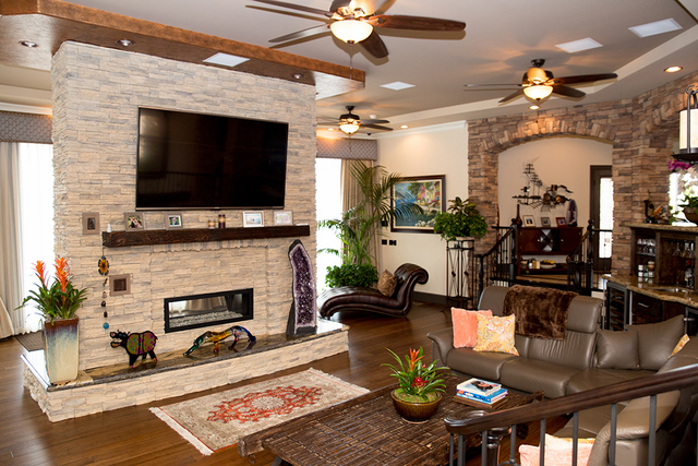 The great room has a modern fireplace. (TONYA HARVEY/REAL ESTATE MILLIONS)