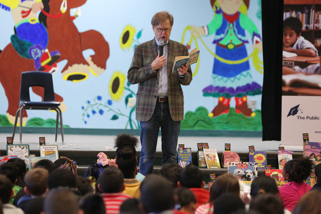 Comedy magician Mac King reads a book during an assembly at Bunker Elementary School, 6350 Peak Drive, as part of his Magical Literacy Tour March 4, 2015. (Erik Verduzco/View) (Click for more photos)