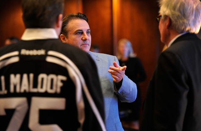 Gavin Maloof, center, speaks with his brother, Joe Maloof, left, and Bill Foley during a promotional stop to sell season hockey tickets at the Southern Highlands Golf Club on Monday, Feb. 23, 2015 ...