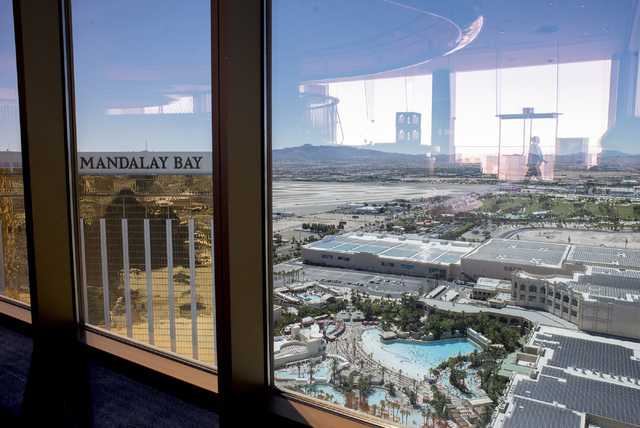 The windows at Delano's Skyfall lounge look out Friday over the solar power farm atop the convention center at Mandalay Bay, which now ranks as the largest rooftop array in the nation. (Bridget Be ...