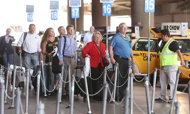 Passengers lined up to get taxi outside of Terminal-1 at McCarran International Airport on Tuesday, April 26, 2016. Bizuayehu Tesfaye/Las Vegas Review-Journal Follow @bizutesfaye
