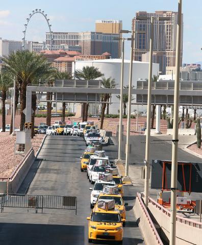 Taxi drivers lined up to pick up passengers from McCarran International Airport on Tuesday, April 26, 2016. (Bizuayehu Tesfaye/Las Vegas Review-Journal) Follow @bizutesfaye