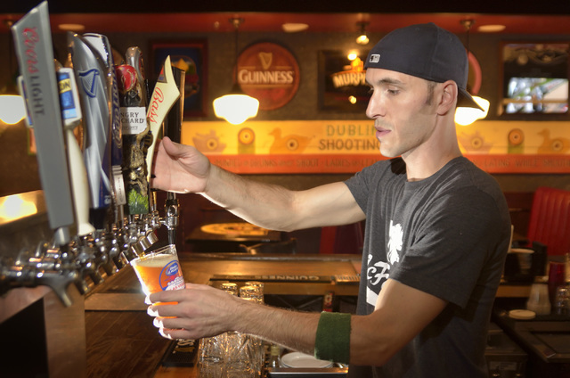 Bartender John Hilden pulls a beer at McFadden's Restaurant and Saloon in Town Square at 6593 Las Vegas Blvd. South in Las Vegas on Saturday, June 4, 2016. Bill Hughes/Las Vegas Review-Journal