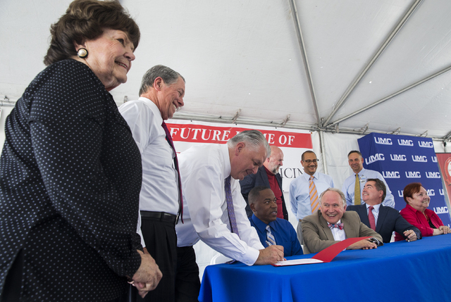 Las Vegas Councilwoman Lois Tarkanian, from left, University Medical Center Governing Board Chairman John O'Reilly and Clark County Commission Chairman Steve Sisolak take part in a ceremony to com ...