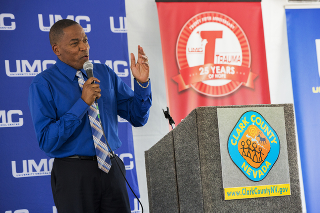 Clark County Commissioner Lawrence Weekly addresses the crowd during a ceremony to commemorate the commission's decision to give UNLV a 9-acre plot of land to build a new medical school Tuesday, J ...