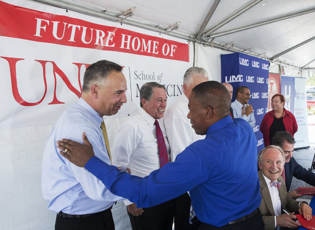 University Medical Center CEO Mason Van Houweling, left, shakes hands with Clark County Commissioner Lawrence Weekly during an event to commemorate the commission's decision to give UNLV a 9-acre  ...