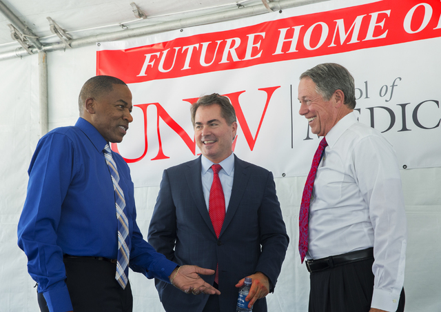 Clark County Commissioner Lawrence Weekly, from left, UNLV President Len Jessup and University Medical Center Governing Board Chairman John O'Reilly socialize at the conclusion of an event to comm ...