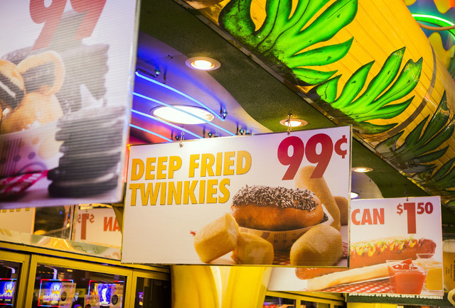 Signs promoting food hangs in front of Mermaid's Casino, 32 Fremont St., on Tuesday, June 21, 2016. The casino will be closing next Monday night. (Jeff Scheid/Las Vegas Review-Journal) Follow @jls ...