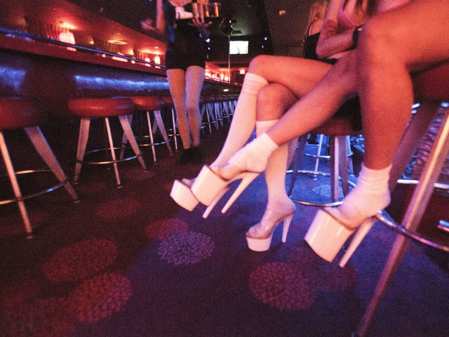 Dancers at Girls of Glitter Gulch, 20 Fremont St., sit while waiting for costumers on Tuesday, June 21, 2016. Downtown's only strip club will be closing next Monday night.(Jeff Scheid/Las Vegas Re ...