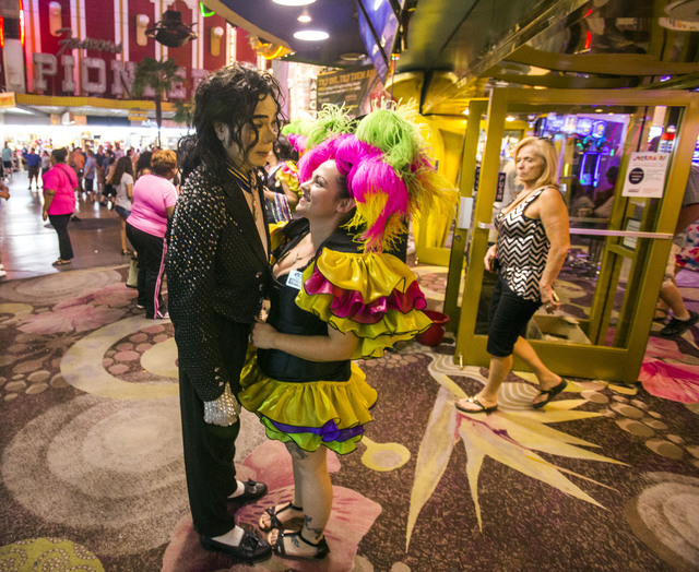 Hostesses Amy Spindle, right, talks to Micheal Jackson impersonator Lane Lassiter in front of Mermaid's Casino, 32 Fremont St., on Tuesday, June 21, 2016. The casino will be closing next Monday ni ...