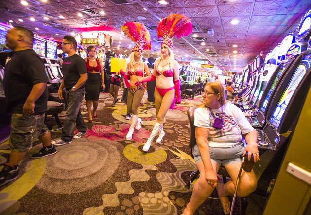Women dressed as showgirls walk through the Mermaid's Casino, 32 Fremont St., on Tuesday, June 21, 2016. The casino will be closing next Monday night. (Jeff Scheid/Las Vegas Review-Journal) Follow ...