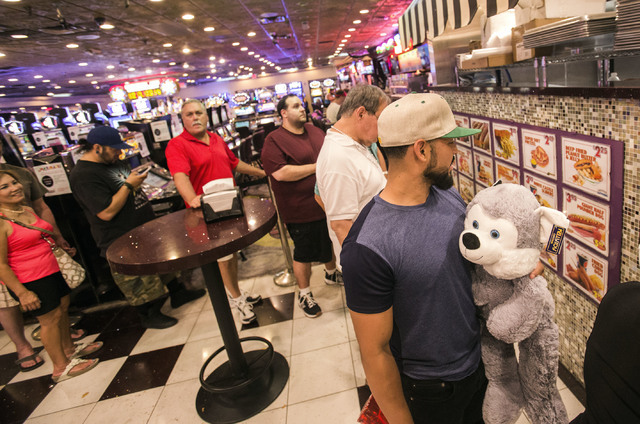 Fransisco Alvarez holds a stuffed animal he won while standing in line at the Mermaid's Casino lunch counter on Tuesday, June 21, 2016. The casino will be closing next Monday night. (Jeff Scheid/L ...