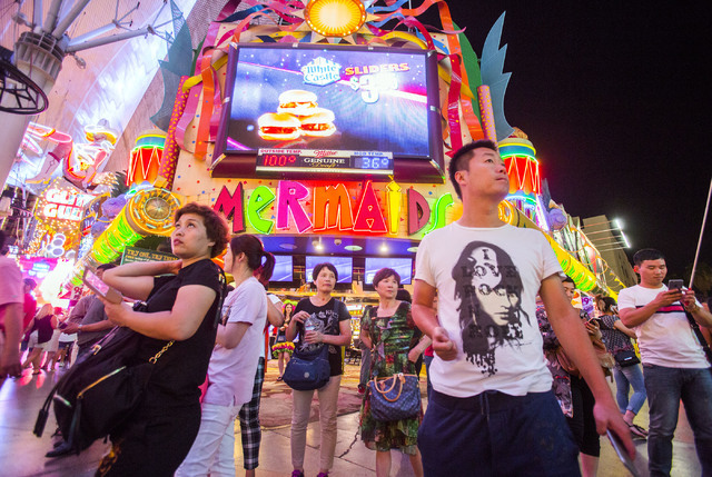 People stand in front of Mermaid's Casino, 32 Fremont St., on Tuesday, June 21, 2016. The casino will be closing next Monday night. (Jeff Scheid/Las Vegas Review-Journal) Follow @jlscheid