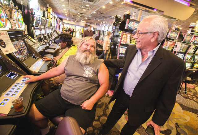 Rudy Nino, right, general manager at Granite Gaming who owns Girls of Glitter Gulch strip club, Mermaid's Casino and La Bayou Casino, talks to costumer Jim Breeher at Mermaid's on Tuesday, June 21 ...