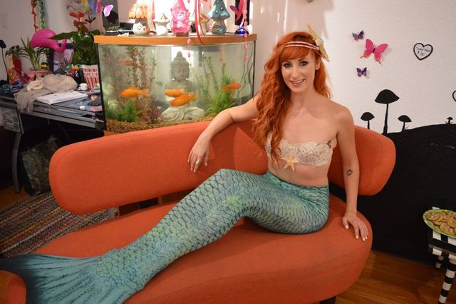 Actress and dancer Kady Heard slipped on a mermaid tail to pose for photos with gallery goers at the inaugural group show at The Bubblegum Gallery. Shannon Mikkelsen/Special to View