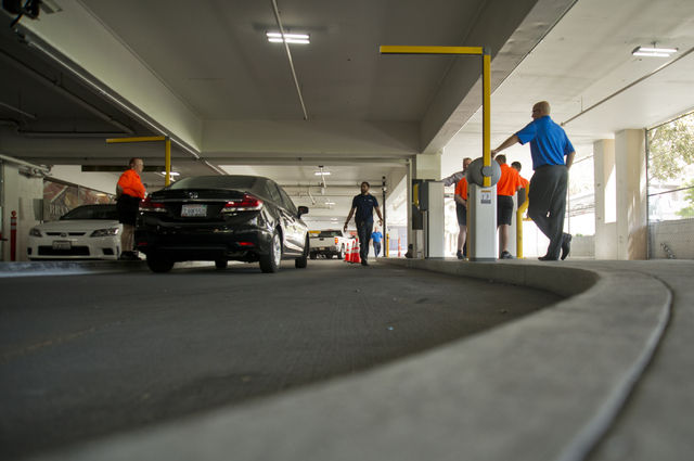 Staff help visitors on the first day of paid parking at the Monte Carlo hotel-casino parking garage on the Las Vegas Strip on Monday, June 6, 2016. Daniel Clark/Las Vegas Review-Journal Follow @Da ...