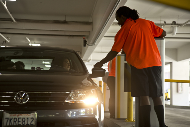 Matthew Smith helps a visitor enter the garage on the first day of paid parking at the Monte Carlo hotel-casino parking garage on the Las Vegas Strip on Monday, June 6, 2016. Daniel Clark/Las Vega ...