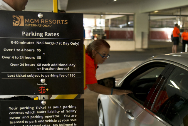 Viv Fasulo helps a customer enter the parking garage on the first day of paid parking at the Monte Carlo hotel-casino parking garage on the Las Vegas Strip on Monday, June 6, 2016. Daniel Clark/La ...