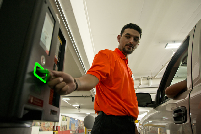 Rafael Lopez helps a visitor exit the parking garage on the first day of paid parking at the Monte Carlo hotel-casino parking garage on the Las Vegas Strip on Monday, June 6, 2016. Daniel Clark/La ...