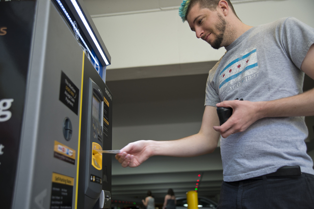 Haylen Jensen uses a kiosk to pay for his parking on the first day of paid parking at the Monte Carlo hotel-casino parking garage on the Las Vegas Strip on Monday, June 6, 2016. Daniel Clark/Las V ...