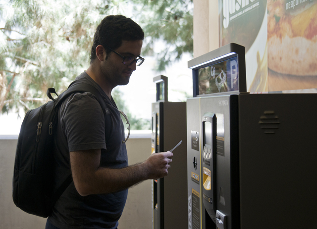 Bam Azizi uses a kiosk to pay for his parking on the first day of paid parking at the Monte Carlo hotel-casino parking garage on the Las Vegas Strip on Monday, June 6, 2016. Daniel Clark/Las Vegas ...