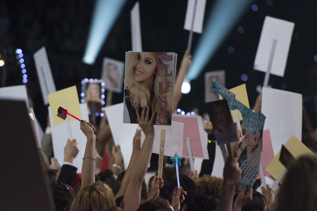 Audience members hold up signs during the Miss USA pageant at T-Mobile Arena in Las Vegas, Sunday, June 5, 2016. (Jason Ogulnik/Las Vegas Review-Journal)