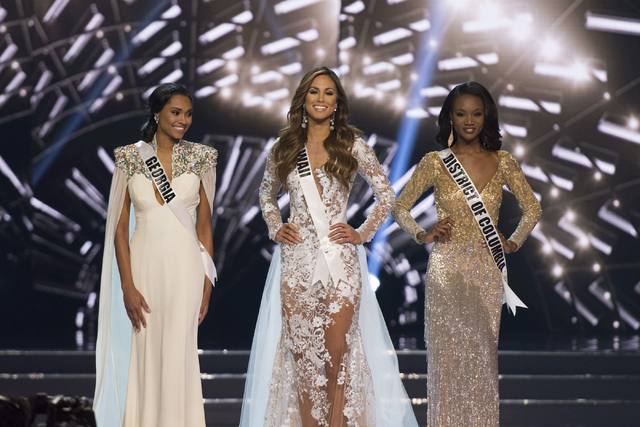 Miss Georgia, Emanii Davis, left, Miss Hawaii, Chelsea Hardin, and Miss District of Columbia, Deshauna Barber, are seen during the Miss USA pageant at T-Mobile Arena in Las Vegas, Sunday, June 5,  ...