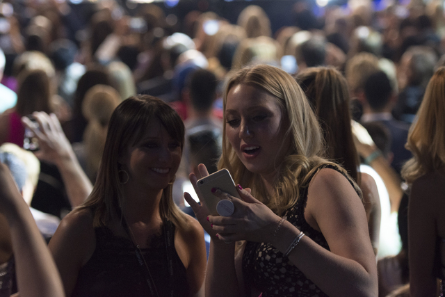 Audience members take a selfie as the Backstreet Boys perform during the Miss USA pageant at T-Mobile Arena in Las Vegas, Sunday, June 5, 2016. (Jason Ogulnik/Las Vegas Review-Journal)