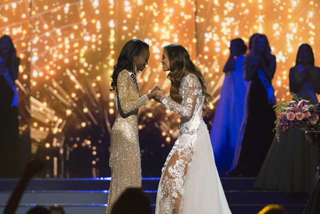 Miss District of Columbia, Deshauna Barber, left, and Miss Hawaii, Chelsea Hardin, are seen just before Miss District of Columbia is crowned Miss USA during the Miss USA pageant at T-Mobile Arena  ...