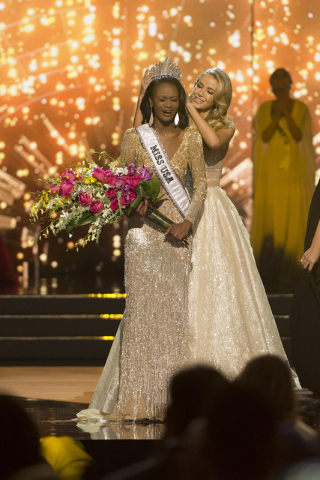 Miss District of Columbia, Deshauna Barber is crowned Miss USA by last year's Miss USA, Olivia Jordan, during the Miss USA pageant at T-Mobile Arena in Las Vegas, Sunday, June 5, 2016. (Jason Ogul ...