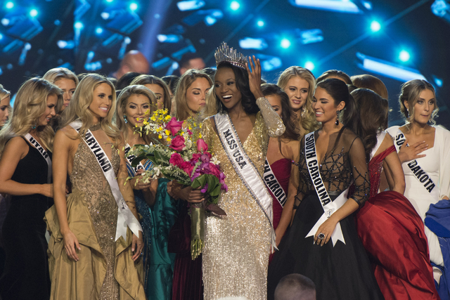 Miss District of Columbia, Deshauna Barber, center, celebrates with the other contestants after being crowned Miss USA during the Miss USA pageant at T-Mobile Arena in Las Vegas, Sunday, June 5, 2 ...