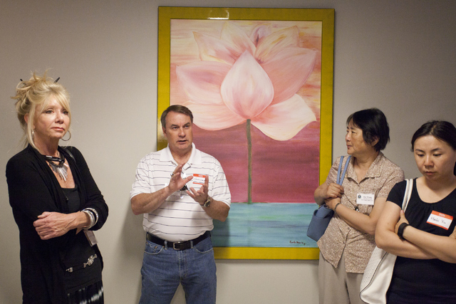 John Cole asks the employees of Silver Sage Wellness, a marijuana dispensary, about medical marijuana and how it is helping veterans on Friday, June 3, 2016, in Las Vegas. )Loren Townsley/Las Vega ...