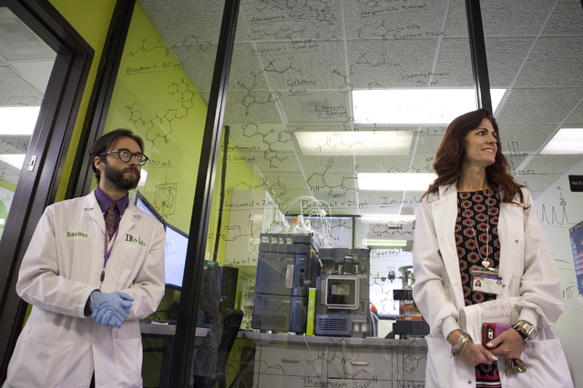 DB Labs director Savino Sguera, right, and CEO Susan Bunce give a tour of their lab on Friday, June 3, 2016, in Las Vegas. DB Labs is the first lab licensed to test medical marijuana in Southern N ...