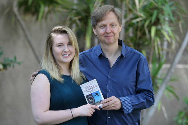 "Mac King and his daughter Elizabeth pose with their copy of Harper Lee's ""To Kill a Mocking Bird"" at their home on Thursday, July 2, 2015, in Las Vegas. (James Tensuan/Las Vegas-Review Journal) Fo ..."