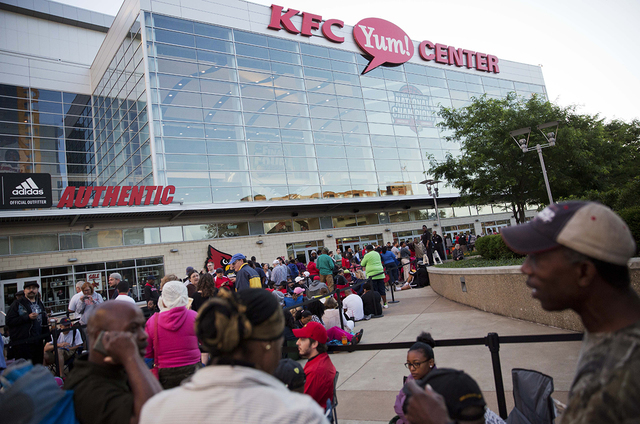 People wait in line for the box office to open for tickets to Muhammad Ali's memorial service Friday at the KFC Yum! Center Wednesday, June 8, 2016, in Louisville, Ky. Ali's memorial service Frida ...