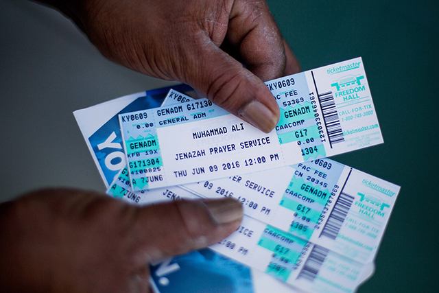 Gregory Penick, of Louisville, holds his tickets for Muhammad Ali's Jenazah service after waiting for the box office to open at Freedom Hall Tuesday, June 7, 2016, in Louisville, Ky. The day befor ...