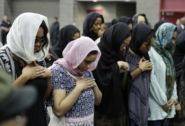 Women pray during Muhammad Ali's Jenazah, a traditional Islamic Muslim service, in Freedom Hall, Thursday, June 9, 2016, in Louisville, Ky. (David Goldman/AP)