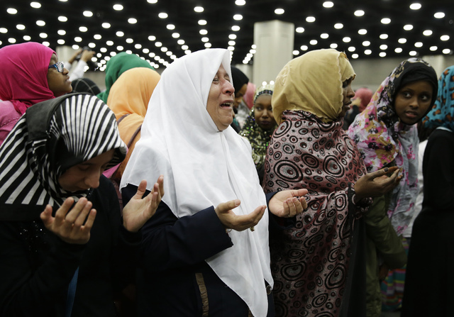 Muslim women pray before Muhammad Ali's Jenazah, a traditional Islamic Muslim service, in Freedom Hall, Thursday, June 9, 2016, in Louisville, Ky. (Darron Cummings/AP)