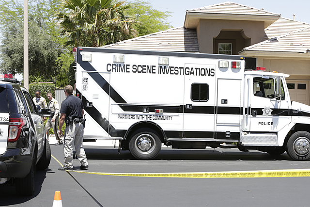 Metro's crime scene investigations truck arrives at the scene of an apparent double murder-suicide at 10301 Wood Owl Court, near Town Center Drive and Hualapai Way on Wednesday, June 1, 2016. Bizu ...