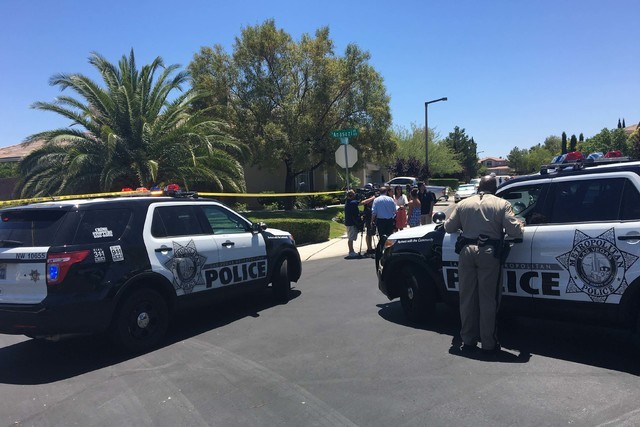 Las Vegas police are investigating a possible double murder-suicide at 10301 Wood Owl Court, near Town Center Drive and Hualapai Way, in the western Las Vegas Valley, Wednesday, June 1, 2016.
