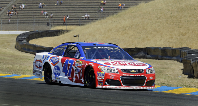 AJ Allmendinger drives during a qualifying lap for the NASCAR Sprint Cup Series auto race Saturday, June 25, 2016, in Sonoma, Calif. Allmendinger won the second position beside pole winner Carl Ed ...