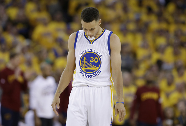 Golden State Warriors guard Stephen Curry (30) walks on the floor during the second half of Game 5 of basketball's NBA Finals against the Cleveland Cavaliers in Oakland, Calif., Monday, June 13, 2 ...