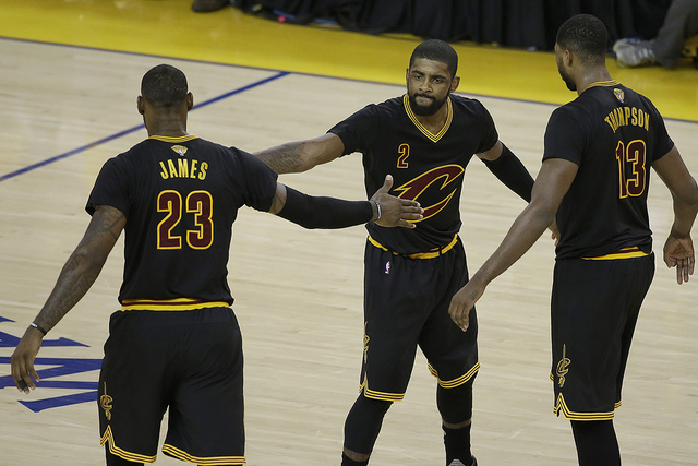 Cleveland Cavaliers guard Kyrie Irving (2), forward LeBron James (23) and center Tristan Thompson (13) react during the second half of Game 5 of basketball's NBA Finals against the Golden State Wa ...