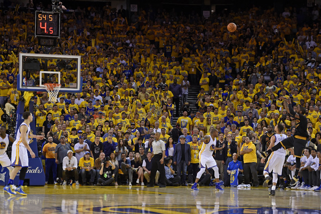 Cleveland Cavaliers guard Kyrie Irving, right, shoots a 3-point basket against the Golden State Warriors during the second half of Game 7 of basketball's NBA Finals in Oakland, Calif.,. (Jose Carl ...