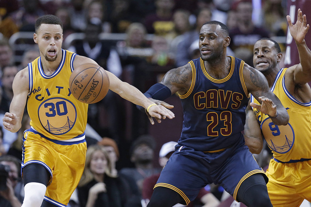 In this Jan. 18, 2016, photo, Golden State Warriors' Stephen Curry (30) knocks the ball loose from Cleveland Cavaliers' LeBron James (23) duriing the first half of an NBA game in Cleveland. (Ton ...