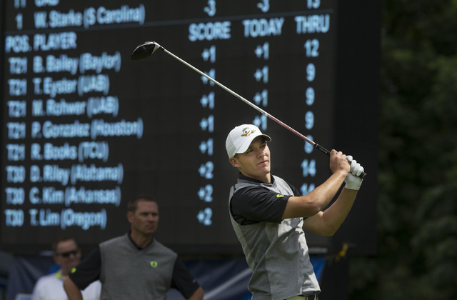 Oregon's Aaron Wise tees off in front of the leaderboard on the 13th hole during the first day of the NCAA college men's golf championships Friday, May 27, 2016, in Eugene, Ore. (Chris Pietsch/The ...