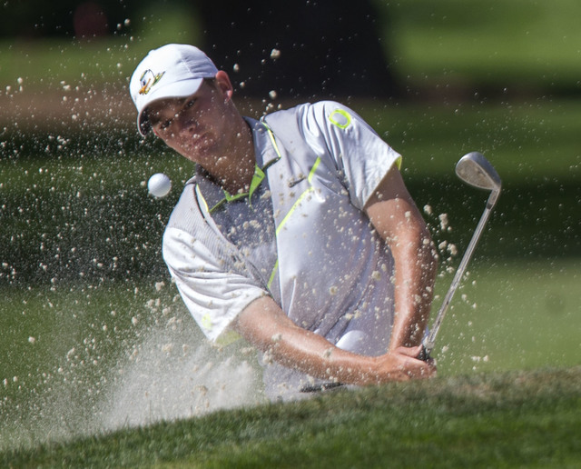 Oregon's Aaron Wise hits out of a bunker during his semifinal against Illinois' Dylan Meyer at the the NCAA men's golf championships at Eugene Country Club in Eugene, Ore., on Tuesday, May 31, 201 ...
