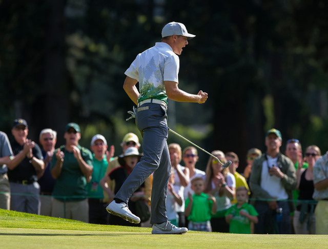 Oregon's Aaron Wise celebrates a birdie on the 17th hole at the NCAA Division I men's college golf championship at Eugene Country Club in Eugene, Ore., Monday, May 30, 2016. (Brian Davies/The Regi ...