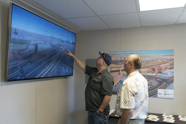 Steve VanHoove, left, and Jess Meyers are seen during a Project Neon preview event at the Spaghetti Bowl construction project's trailer at 320 Wall St. in Las Vegas Wednesday, June 15, 2016. Jason ...